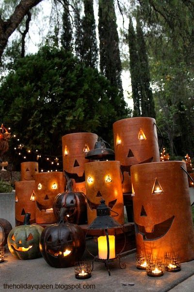 Home depot pottery pumpkin luminaries assembled to create a garden divider halloween style Halloween decorations home depot