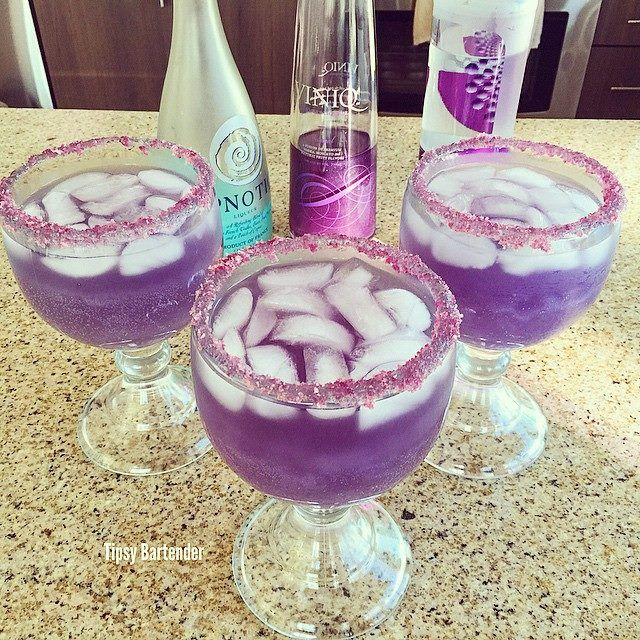Purple Alluring Lullaby: 2 oz. Viniq 1/2 oz. Hpnotiq 1/2 oz. Grape Vodka Top with Lemon Lime Soda
