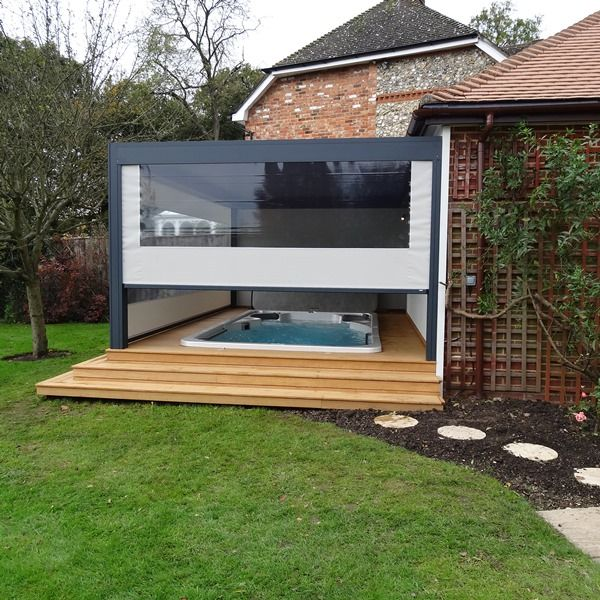 Renson Camargue Louvered Roof Terrace Cover with 2 automatic side screens with crystal windows designed and installed by us at Garden House Design