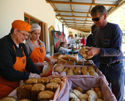 The Bakery team selling freshly baked loaves of bread at our monthly market.