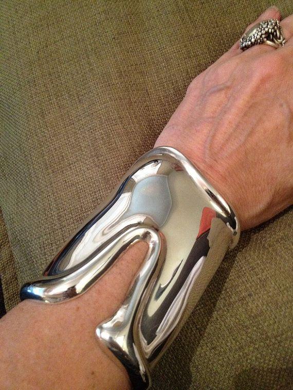Vintage Tiffany & Co. 1975 Elsa Peretti Long Bone Sterling Silver Cuff   by ArtDecoAntiques, $2275.00] https://www.etsy.com/ca/listing/102733259/tiffany-co-1975-elsa-peretti-long-bone