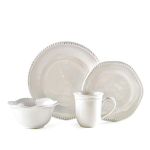 HAMPTON HOME DINNERWARE SET - SET OF 16 Destined to become a family heirloom, this classically simple brilliant white stoneware dinnerware set is unadorned except for elegantly beaded edges. Slight distressing adds vintage appeal. Fired at higher temperatures than ceramic pieces to increase durability and prevent chipping. Durable enough for everyday use, they are dishwasher and microwave safe. ON SALE