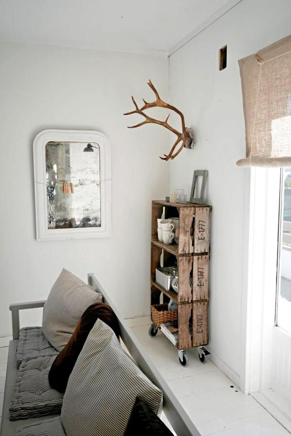 Cool wooden shelves and antlers.