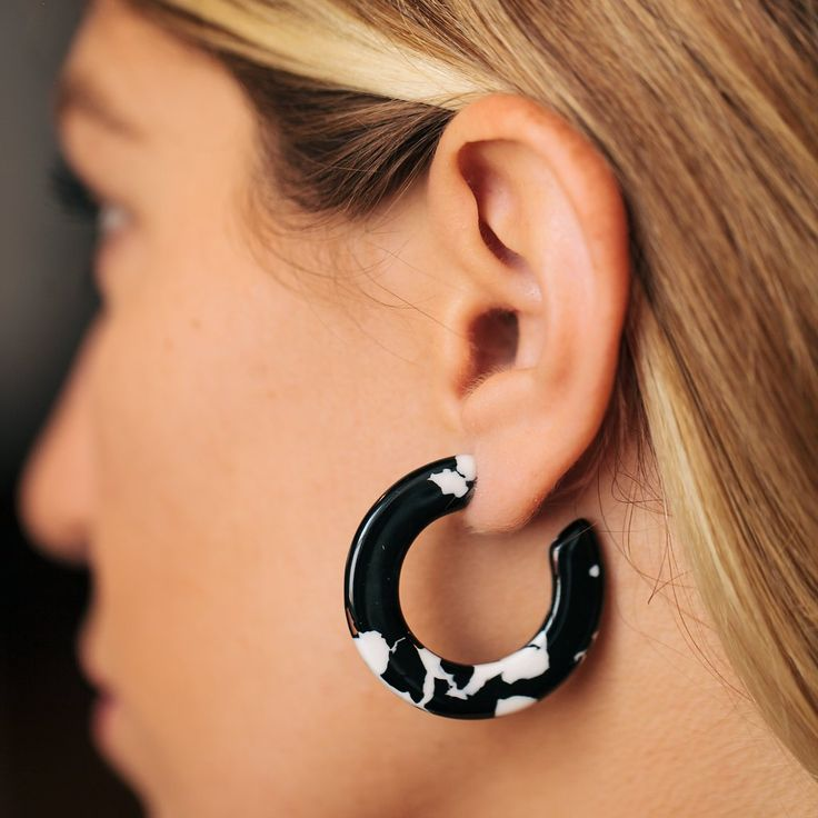 """The bold print on these earrings make them the perfect accessory to add a subtle edgeto an everyday look.Italian made and imported acetateStainless steel postsMeasures 1.5"""" in diameterHypoallergenicGood for sensitive ears"""