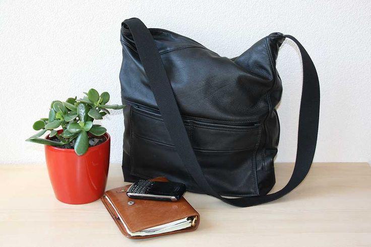 Zwarte leren tas, handgemaakt van hergebruikt leer. Een grote, stoere leren tas, die zowel door heren als dames gebruikt kan worden.
