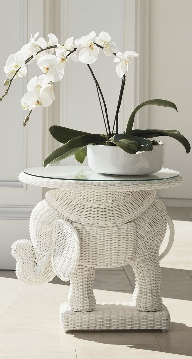 In keeping with this animal symbol of strength and longevity, the Woven Elephant Side Table is crafted by hand of long-lasting, weather resistant resin wicker.  | Frontgate: Live Beautifully Outdoors