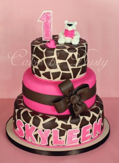 Pink and giraffe cake. Perfect for a first birthday party!