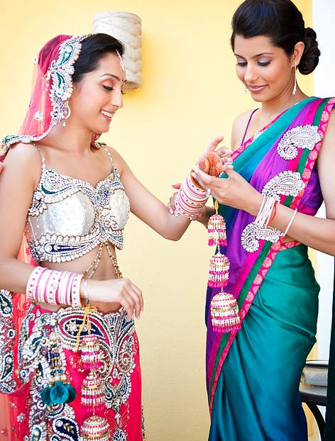 Modern Indian bride.  Modern punjabi bride.  Churra.   Bridesmaid sari.