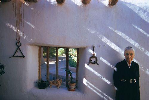 Georgia O'Keeffe at her Abiquiu New Mexico home and studio.