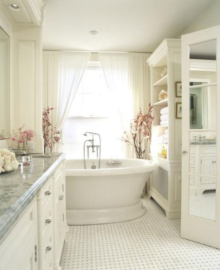 Gallery One Romantic cottage style bathroom designed with white tiles marble counter and our beautiful Balneo