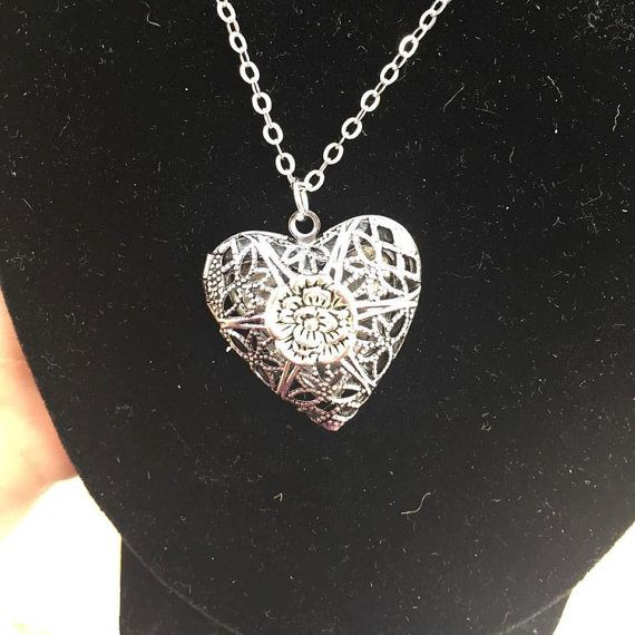 Beautiful detailed antiqued silver heart locket. The filigree locket is beautifully designed and detailed. The locket pendant is on a 16  chain with a lobster clasp. Length of chain can be changed.  Place your special memories of that someone special inside to keep close to your heart at all times. All of my pieces are beautifully, and carefully packaged in tissue paper inside a bubble wrap envelope to ensure they arrive safely. By purchasing this item, you are agreeing to Absolute Southerns…