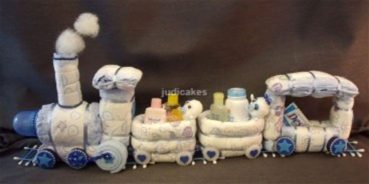 Diaper Cake Train Baby Shower Gift Centerpiece.  If it is a boy and you wanna add some trains in the mix