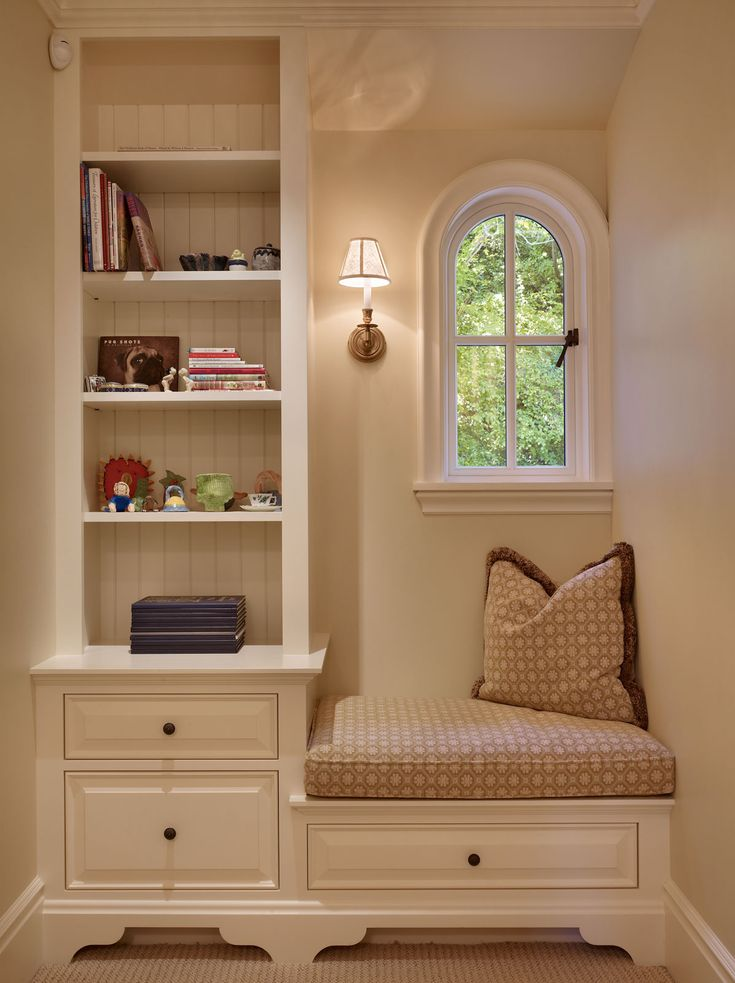 I love this idea for the top of the stairs nook -- a perfect sitting area for little ones & adults plus added storage.