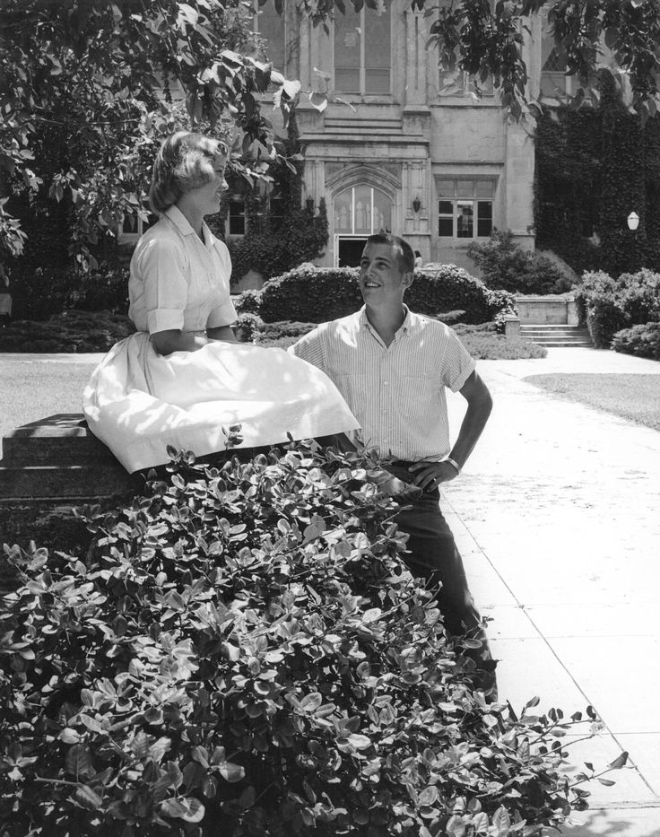 Lovely photograph of a young man and a woman chatting in front of Watson Library, 1950.