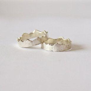 Wedding rings designed with interlocking mountain ranges.