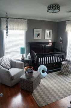 Haven't found many baby boy nursery rooms I like but this one is close. I would rather do white than black though.