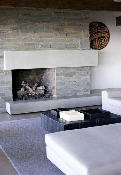 Off center modern stone fireplace