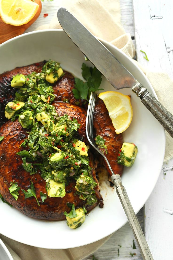 Grilled, marinated portobello steaks with a spicy avocado chimichurri sauce! An incredibly hearty and flavourful 30 minute plant-based meal!