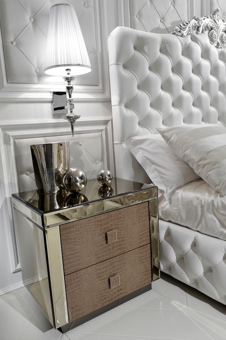 The Alligator Embossed Pattern Leather and Mirrored Bedside Table at Juliettes Interiors is the most stunning piece of contemporary design. Truly versatile. Use as a bedside table as shown, modern side table or as a welcome in any hallway. Adding contemporary style and sophistication to any setting.