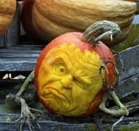Ray Villafane pumpkin with branch arms -  - Learn more about this unique form of pumpkin carving that is perfect for Halloween here: http://www.vegetablefruitcarving.com/ray-villifane-pumpkin-carving-dvd/