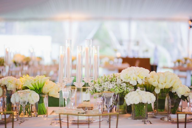 Morgan Stewart's all white centerpieces: http://www.stylemepretty.com/2016/06/20/steal-the-look-morgan-stewarts-glam-all-white-wedding/