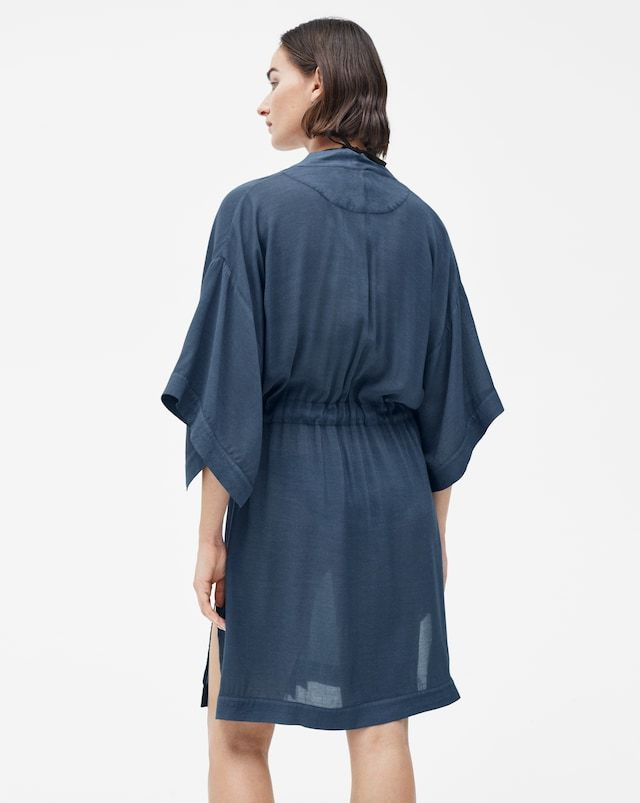Our drapey kimono is the ideal cover-up when hanging out at the beach or by the pool. The relaxed style reaches just above the knee and features slit details at the sides and sleeves, and an attached tie belt at the waist. It's mindfully made from lightwe