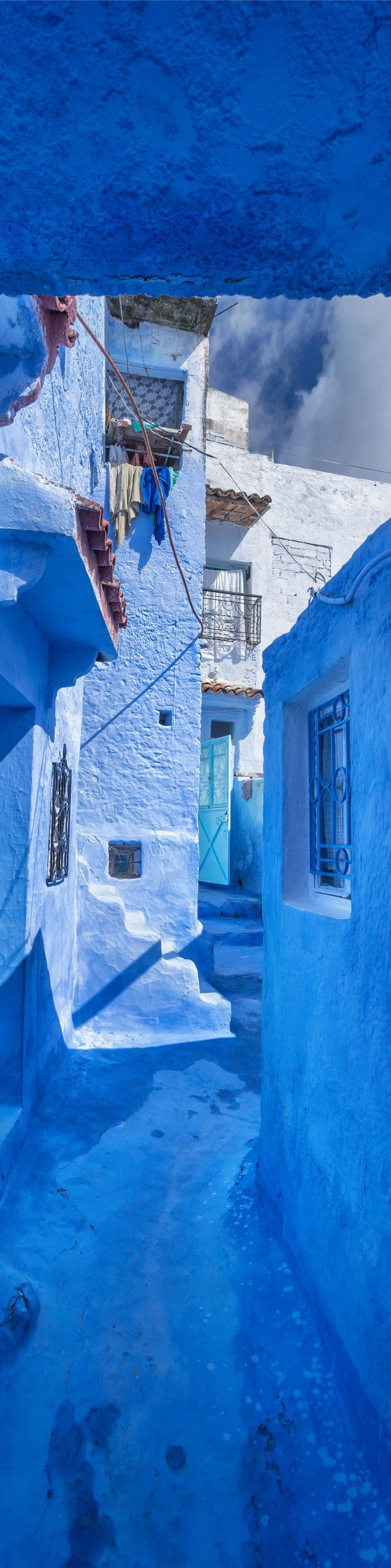 "This little mountain town is painted all in blue! In Morocco - from the Exhibition: ""Cropped for Pinterest"" - photo from #treyratcliff Trey Ratcliff at http://www.StuckInCustoms.com"