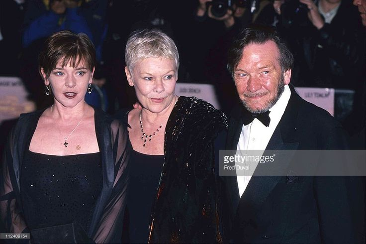 Judi Dench (center) with daughter Finty Williams and husband Michael Williams