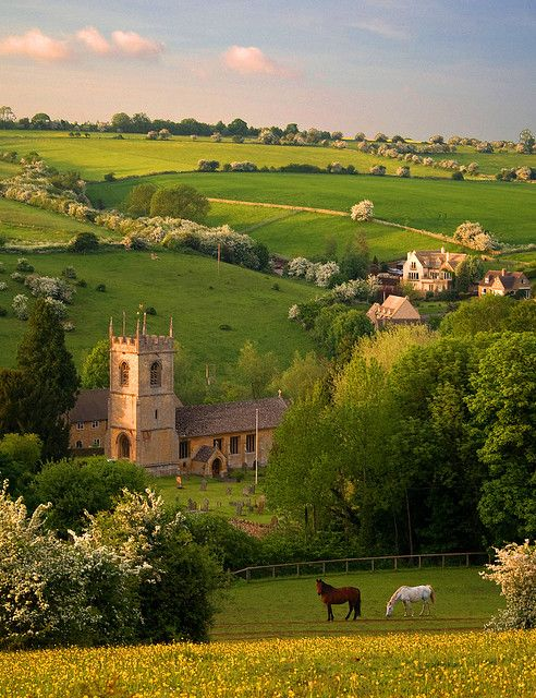 St. Andrews church in the cotswold village of Naunton, in the Windrush valley, Gloucestershire, England. Taken on a late Spring evening