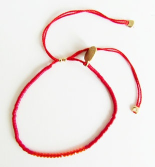 Glass bead and red crystal bracelet: Red glass bead bracelet with Swarovski red crystals  100% silk thread, adjustable size.  $45