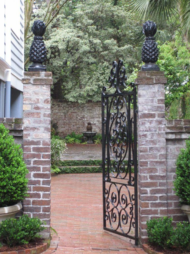 Henhurst Interiors: Southern Charm  pineapples-the sign of hospitality.: Modern Gardens, Charleston Sc, Southern Charms, Gardens Gates, Henhurst Interiors, House, Pineapple, Irons Gates, Courtyards