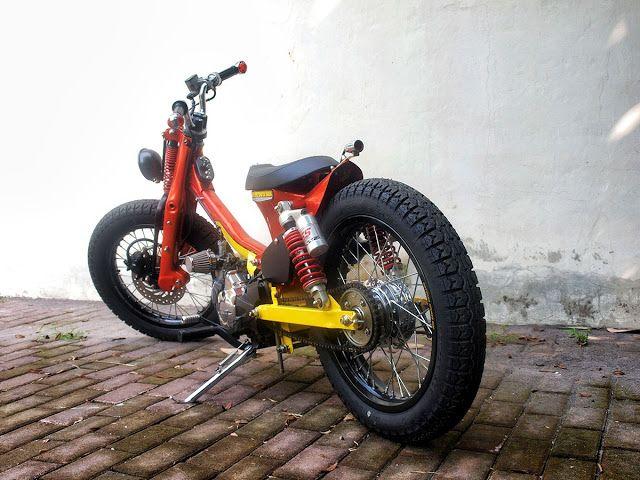 Honda cub on red