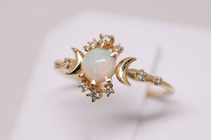 http://sosuperawesome.com/post/161297502788/10-of-our-top-30-opal-rings-on-etsy-ring-1