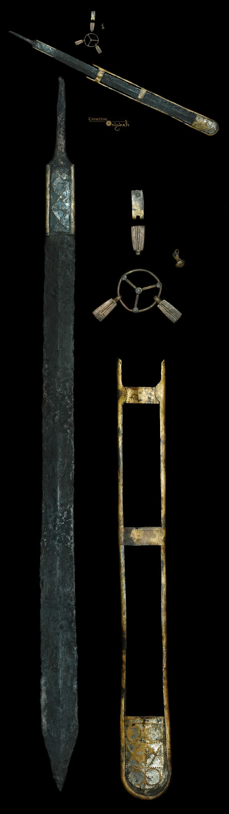 A sword dated  3rd-2nd century BC with sheath and belt suspension hardware.British celts.
