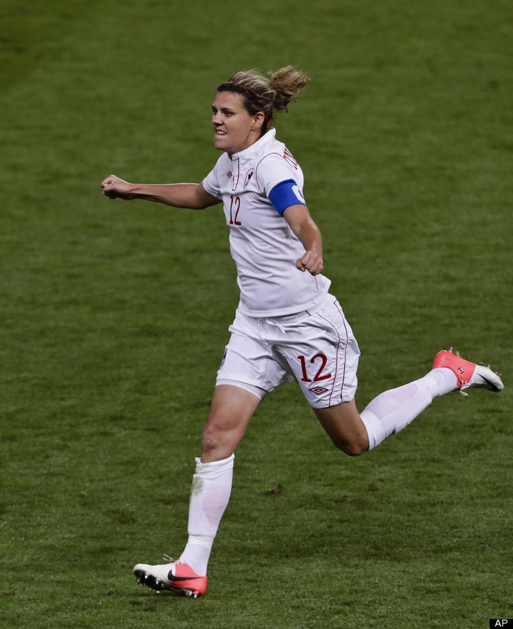 Christine Sinclair, Canada team leader, captain, and hat-trick scorer against the USA and Hope Solo. (AP)