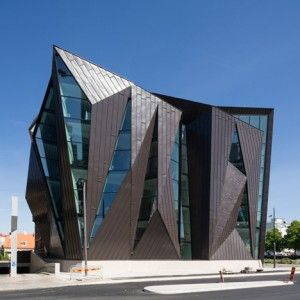 Metal and glass facets surround World Maritime University's new harbourside home