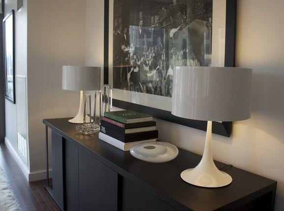 A pair of Flos SPUN Table Lamps (Sebastian Wrong, 2003) provide symmetry on a Maxalto CRESO Sideboard (Antonio Citterio, 2008).