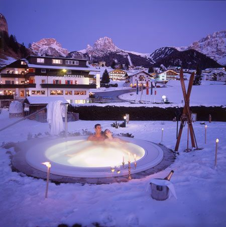 Snowcovered outdoor hot tub at the Alpenroyal Garden Hotel in the Dolomites, Italy