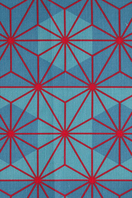 """Traditional Japanese patter """"Asanoha"""" in red against a background of green-blue octagons on linen-cotton canvas via Nekineko"""
