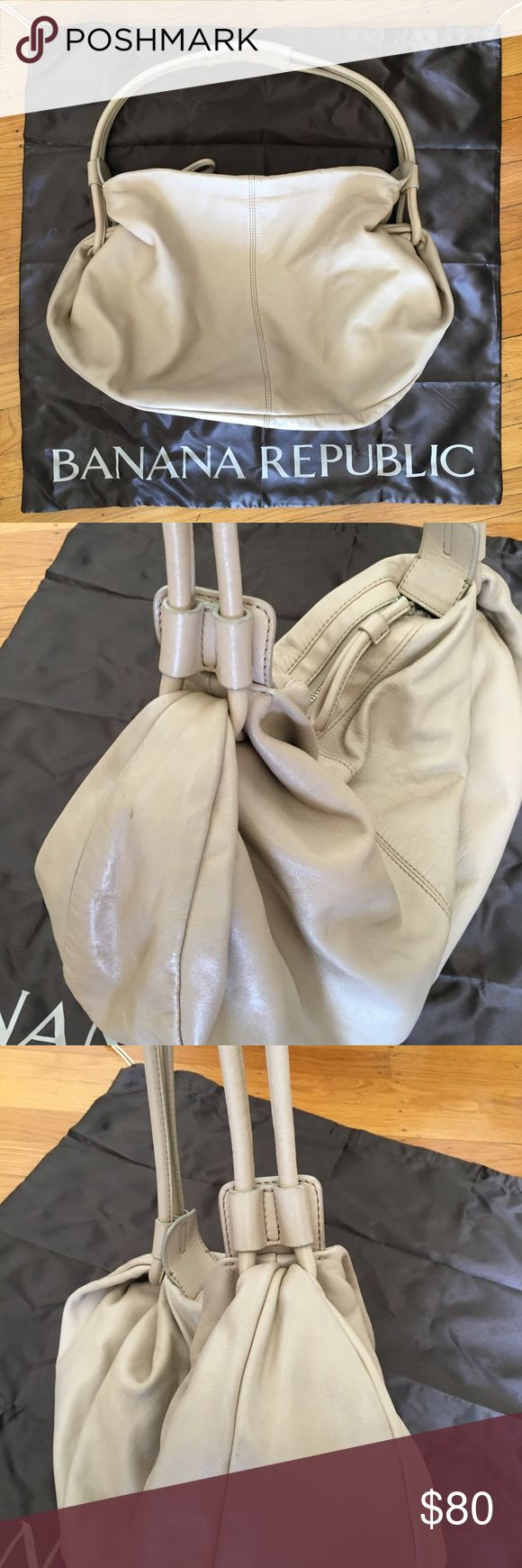 """BR leather purse Light nude blush leather crescent shaped slouchy purse.  Zip top and two interior pockets, one zips shut. Some normal wear under the handle and in the bottom as shown in the photos, not noticeable when wearing.  Otherwise excellent condition.  Dust bag included. 14"""" drop, 16"""" w 11"""" h and 4.5"""" d Banana Republic Bags Hobos"""