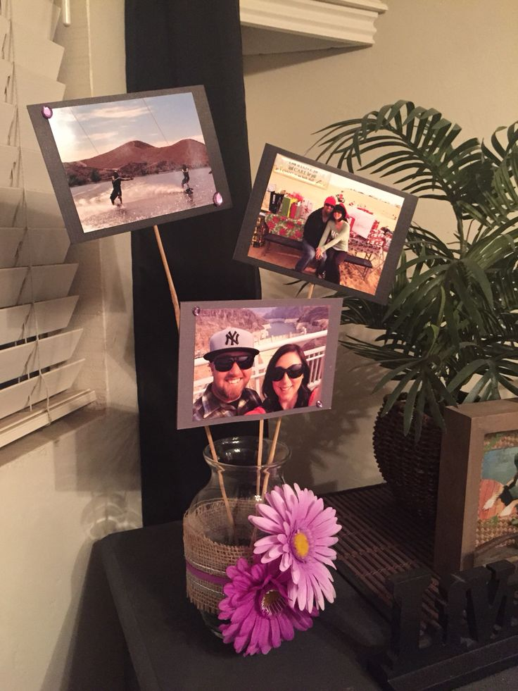 "Made these for table centerpieces at my ""By the beach wedding!"" Double sided pictures, used hot glue gun and card stock paper! I printed 12 photos at Walmart for under $4 and used $1 store materials to decorate the vase! Total project for two approx $12 with extra materials left over."