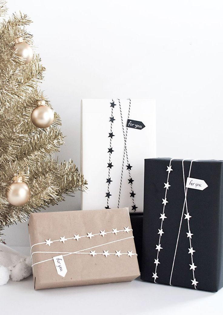 DIY- Star garland gift wrap--string, card stock, paper punch, tacky glue