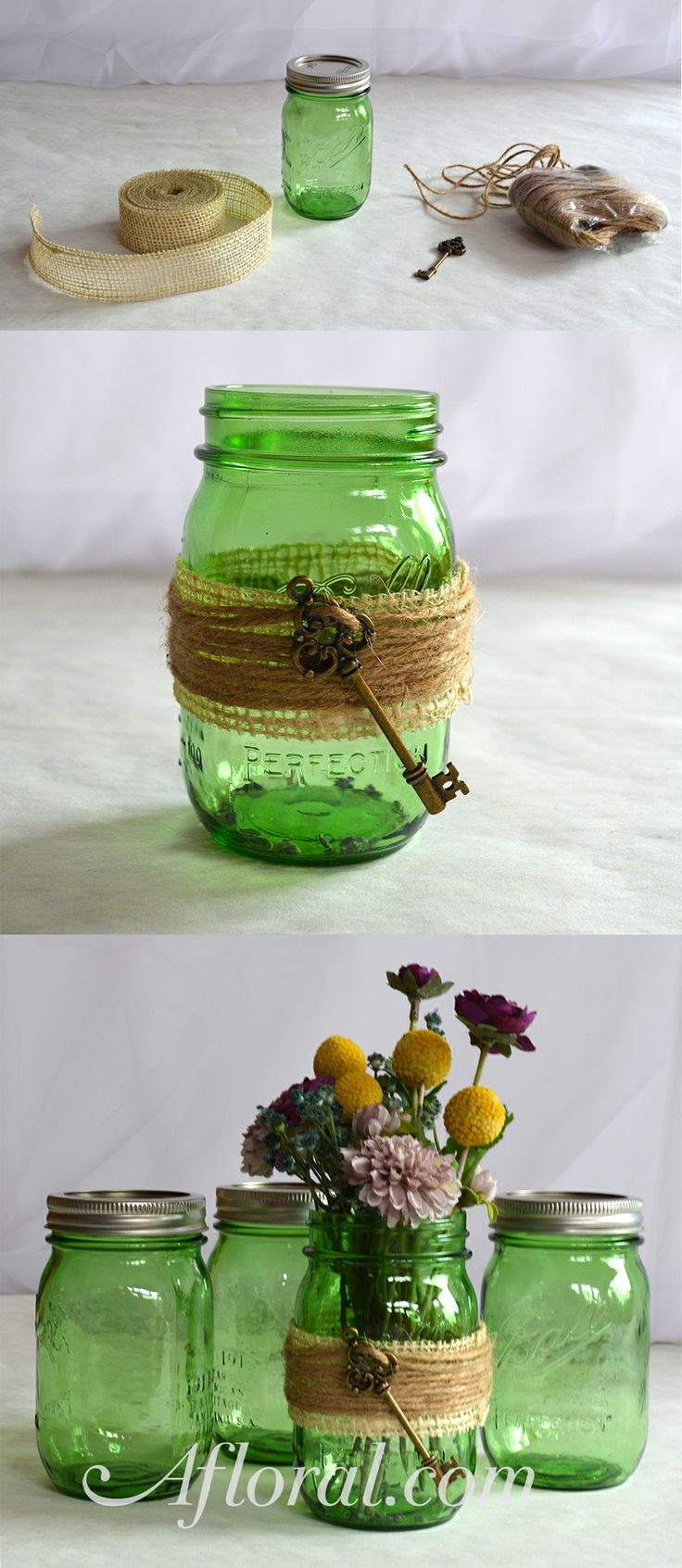 DIY these green mason jar wedding centerpieces! Supplies: green mason jars, burlap ribbon, faux keys, and your favorite rustic silk blooms!