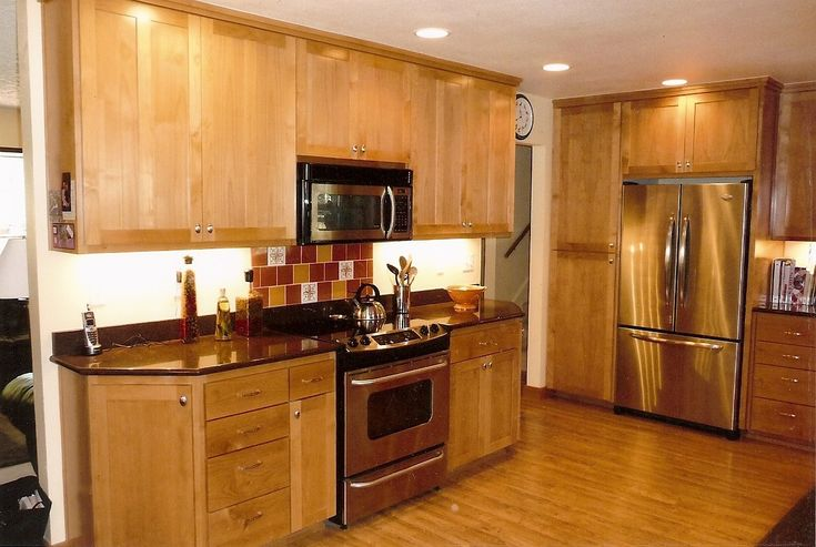 Stainless steel appliances light wood cabinets google for Light kitchen cabinets with dark countertops
