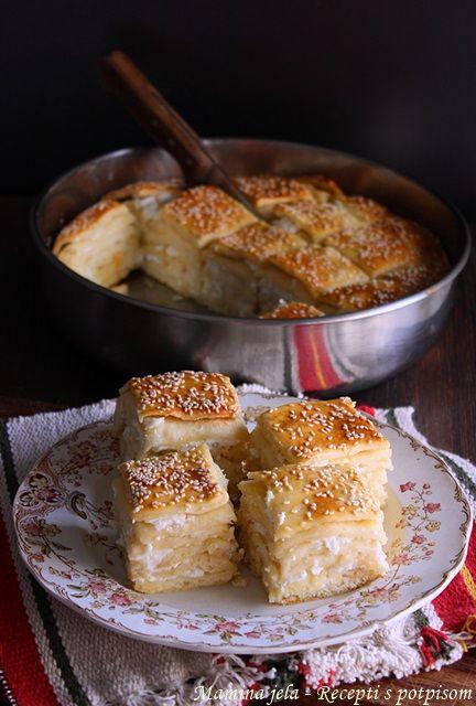 Odlična pita sa kiselim testom, nešto između pogače i pite, ovde možete videti original RECEPT prave Makedonke. Hvala, uživala sam pra...