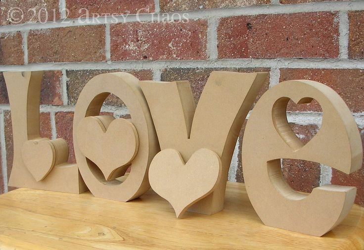 Unfinished Wood LOVE Letters Valentine Decor. $14.99, via Etsy.