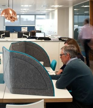 Create some privacy in an open plan workspace with desk partitions / desk dividers / privacy screens. These grey felt desk screens with blue teal trim look great and are moveable so you can put up or down whenever you need them.