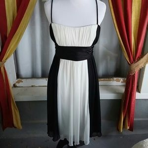 I just added this to my closet on Poshmark: Beautiful black and white cocktail dress. Price: $18 Size: M