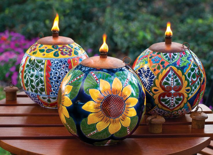 Talavera Style Torch Pots - Acacia 59.95. Stunning, though I am fearful that they'd get trashed by my boys.