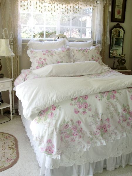Love everything about this bedroom . . . especially the lace curtains!